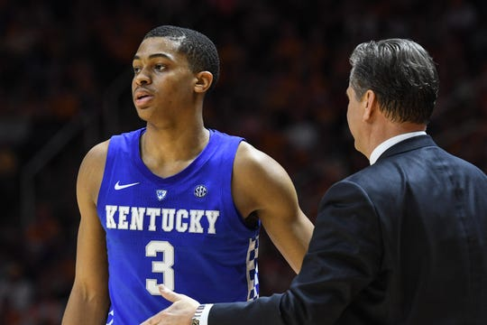 Kentucky Wildcats head coach John Calipari speaks with forward Nick Richards (4)