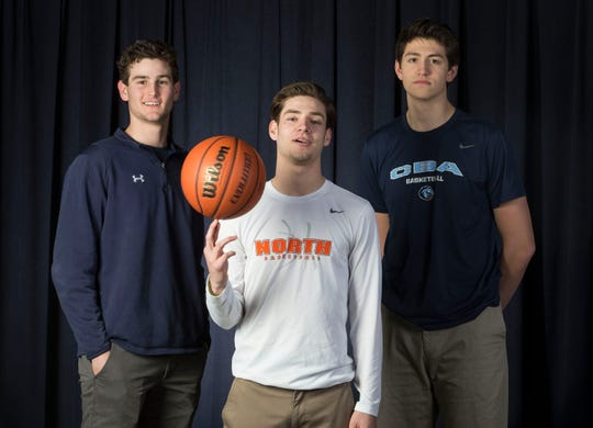 All-Shore Boys Basketball team. Left to right: Alex Galvan of Manasquan, Rob Higgins of Middletown, and Josh Cohen of Christian Brothers Academy. Not pictured are Ranney Schools Bryan Antoine and Scottie Lewis.