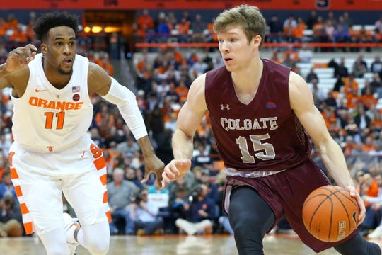 Colgate Raiders guard Tucker Richardson (15) drives to the basket past Syracuse Orange forward Oshae Brissett (11)