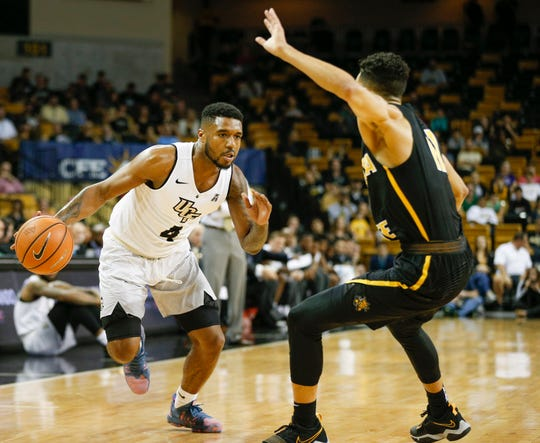 Wichita State Shockers guard Landry Shamet (right) tries to block the path of UCF Knights guard Ceasar DeJesus (4)