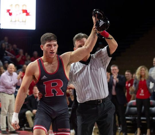 Anthony Ashnault, shown getting his hand raised after a win earlier this season, will, along with Nick Suriano, try and become Rutgers' first NCAA wrestling champions this weekend.