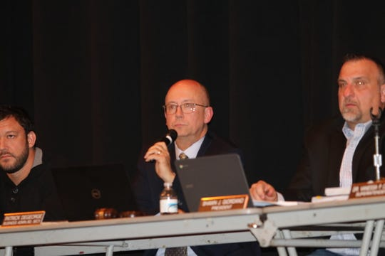 Lacey Business Administrator Patrick DeGeorge takes questions from the public about the the proposed school budget and staff cuts.