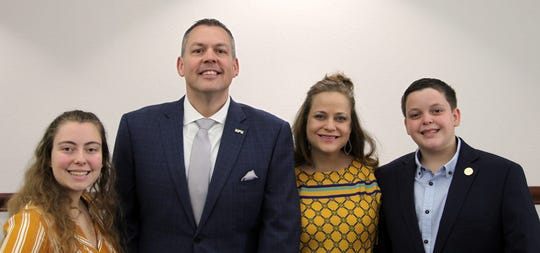 Cory Hines, second from the left, is joined in this photograph by his family, wife, Melinda (second from the right), and children, Mackenzie (left) and Caleb (right). Hines was named 20th president of Howard Payne University Monday and will begin April 1.