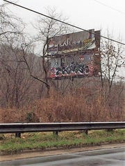 This billboard, visible from I-40 in East Asheville, has become derelict looking because of an access issue, as well as graffiti.