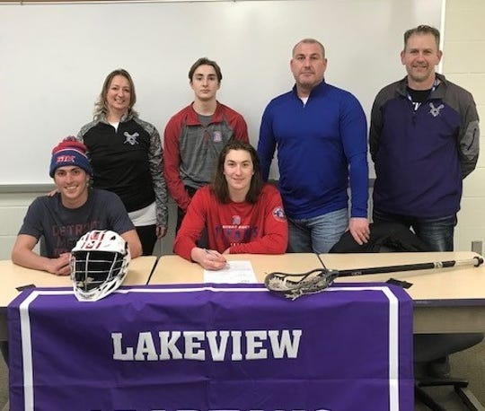 Lakeview's Ryan Lamb signs to play lacrosse at Division 1 University of Detroit Mercy. He is joined by his family and coaches.