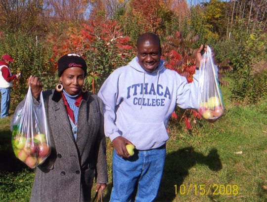 Marie Sonia Bernard and Marc Henry Bernard during an apple-picking trip with the American Civic Association's English-speaking class. The couple, originally from Haiti, were killed in the 2009 mass shooting at the ACA in Binghamton.