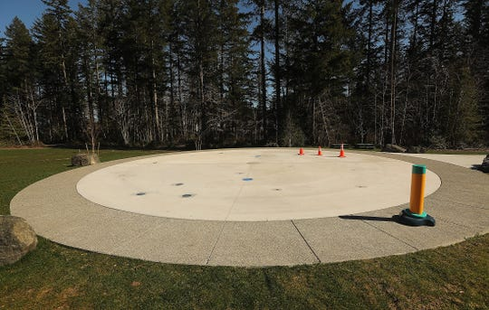 The splash pad awaits completion at McCormick Woods Village Park in Port Orchard. City officials say it will be operational by mid-June.
