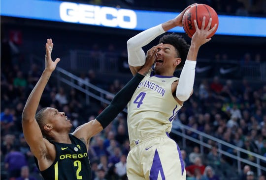 Washington's Matisse Thybulle attempts a shot over Oregon's Louis King during the first half of an NCAA college basketball game in the final of the Pac-12 men's tournament Saturday, March 16, 2019, in Las Vegas.