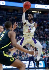 Washington's Jaylen Nowell (5) passes the ball against Oregon during the first half of an NCAA college basketball game in the final of the Pac-12 men's tournament Saturday, March 16, 2019, in Las Vegas.