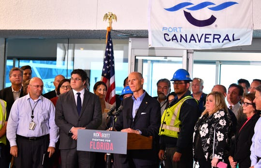 U.S. Sen. Rick Scott, at the podium, and Port Canaveral officials discuss the importance of federal funding for Florida's seaports during a news conference Tuesday at Cruise Terminal 5