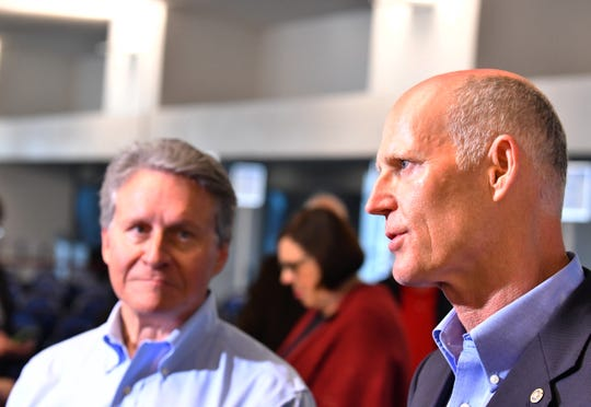 U.S. Sen. Rick Scott, right, held a news conference at Port Canaveral Cruise Terminal 5, pledging to seek more federal money for Florida ports. At left is Port Canaveral Chief Executive Officer John Murray.