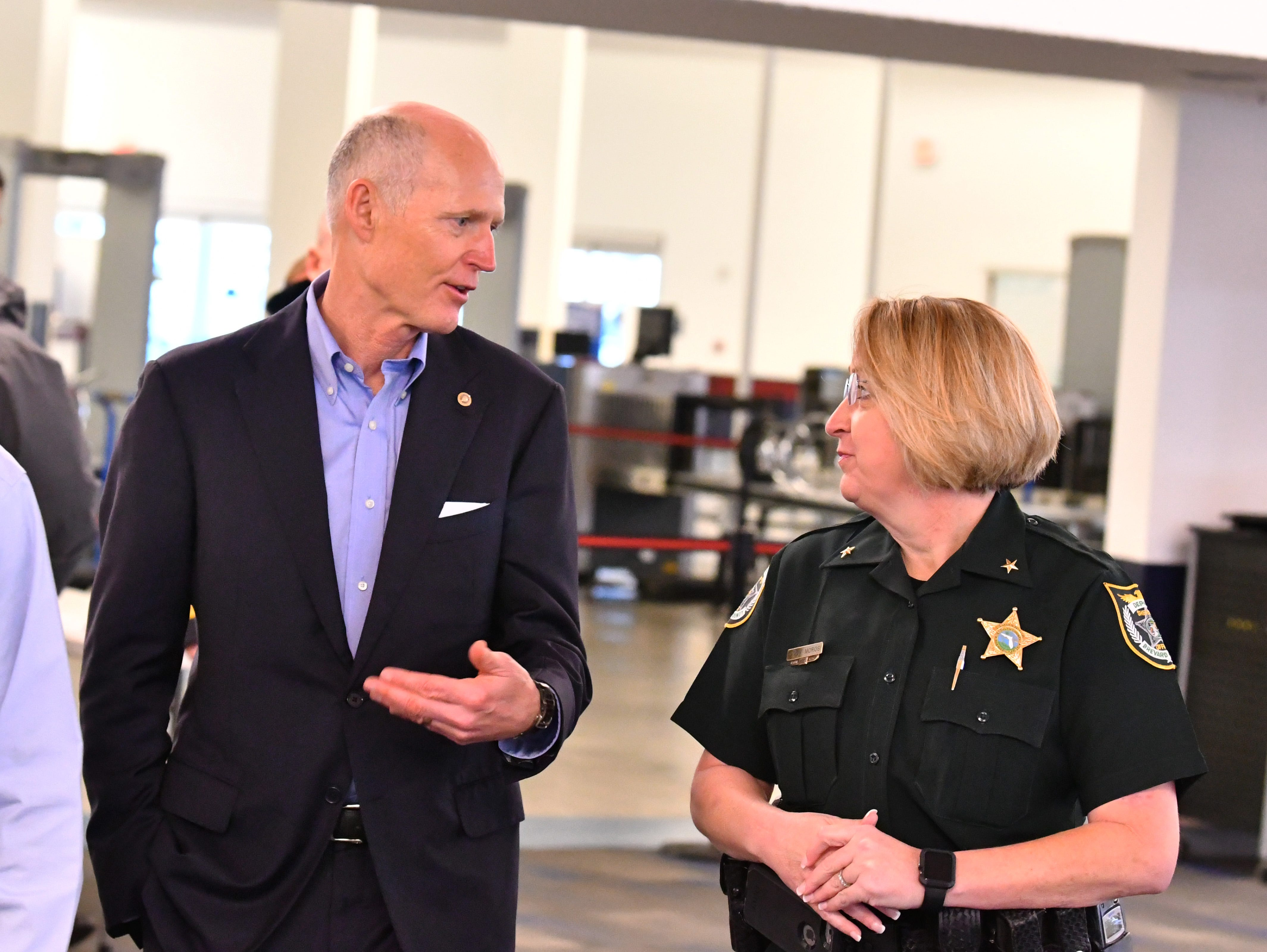 Sen. Rick Scott held a press conference at Terminal 5 Tuesday morning at Port Canaveral, pledging to work for $140 million in the budget for Florida ports. Sen. Scott chats with BCSO Commander Linda Moros on the way in.