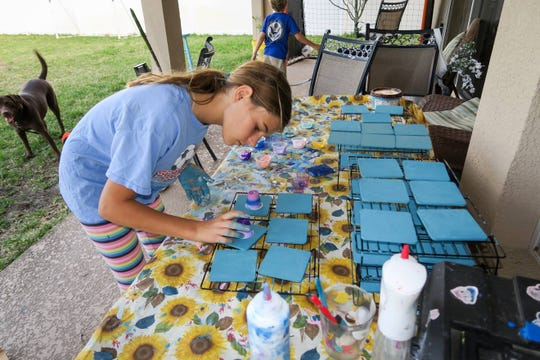 Sienna Shelton, 12, experiments with different art techniques and original ideas to stain wood coasters and wood tissue boxes. She'll be one of 50 young vendors at the Brevard Children's Business Fair on March 30.