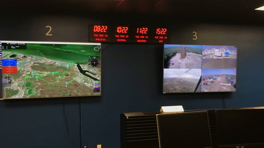 Screens track footage of drones inside NASA's Mission Control Center at Lone Star UAS Center of Excellence & Innovation at Texas A&M Univeristy - Corpus Christi.