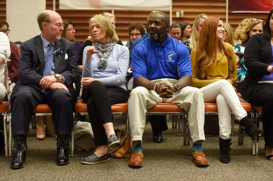 From left to right: Robert Thompson, Patricia Villarreal, Clarence McGill and Azita Pardom sit in their reserved seats before the teacher of the year press conference, Tuesday, March 19, 2019, at the CCISD Administration Building. The Texas state teacher of the year program has honored teachers since 1969.