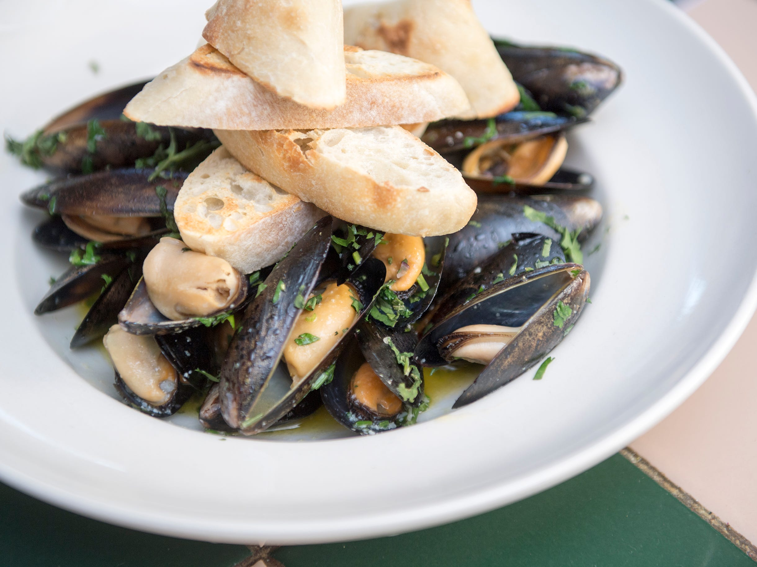 A tequila mussels dish with lime and tequila sauce served with toasted bread from La Esperanza in Lindenwold.