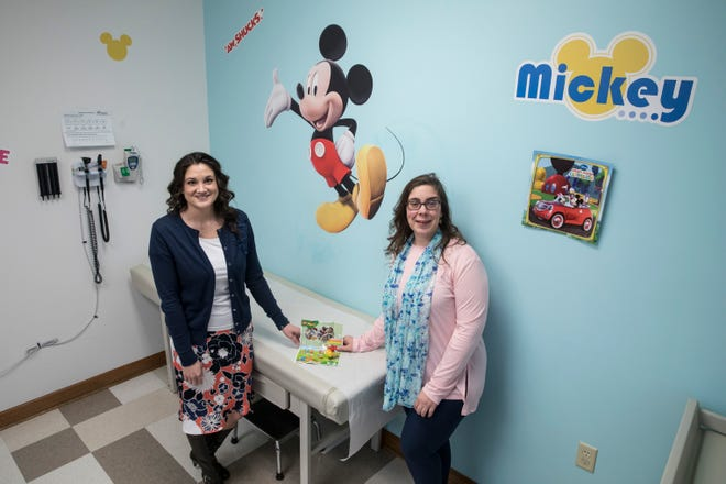 Dr. Heather Sever, left, and Dr. Amy Luckeydoo have started prescribing play for patients in their Chillicothe Pediatrics practice. The doctors signed up for a free program through LEGO at the American Academy of Pediatrics National Conference last year.