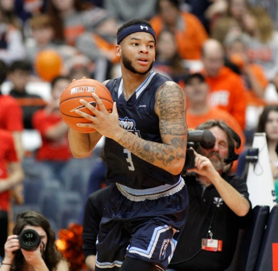 Old Dominion's B.J. Stith looks to pass the ball in the second half of an NCAA college basketball game against Syracuse in Syracuse, N.Y., Saturday, Dec. 15, 2018. Old Dominion won 68-62.