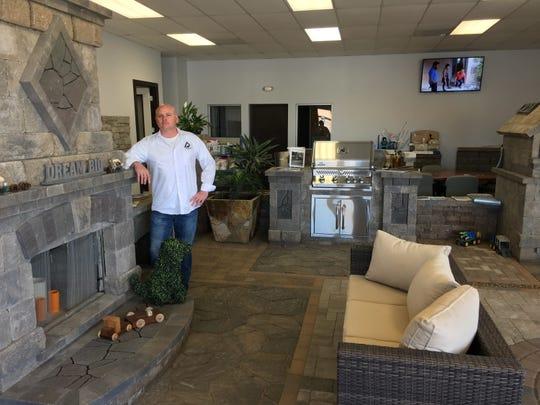 Owner P.J. Shortt works inside AR Stoneworks' new showroom.