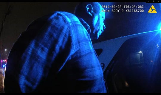 Charles Green before he is led into Edison police vehicle