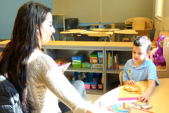 Educational Services Commission of New Jersey (ESCNJ) Speech and Language Pathologist Jessica Geniton working with a Paul Robeson Community School for the Arts student.