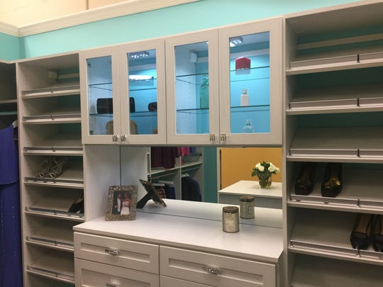 """Everybody likes a little luxury. So, Sophisticated Storage Solutions decided to go out all for its 18th Anniversary and will unveil their newest creation — a """"Bling""""closet complete with Swarovski crystal knobs and drawer pulls. The closet, swathed in elegant Tiffany blue, will be revealed atspecial event at the Chimney Rock Road location on Saturday, March 23."""