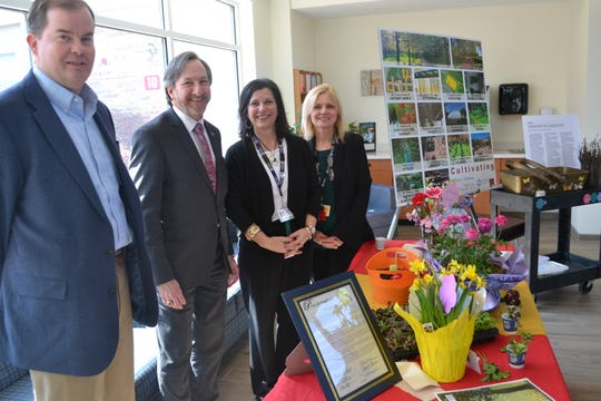 """Somerset County Freeholder Director Brian Levine (second from left)was at Hackensack Meridian Health Carrier Clinic on Thursday, March 14,to declare the week of March 17 to March 23 as Horticultural Therapy Week in Somerset County. Joining him (from left)were Brian J. Schilling, Ph.D., senior associate director, NJ Agricultural Experiment Station, and director, Rutgers Cooperative Extension; Laura DePrado, registered horticultural therapist, and Susan Leight, director of Carrier Clinic's Adult Psychiatric and Addiction unit. Carrier Clinic sponsors an active horticultural therapy program that is overseen by DePrado in support of its patients. Levine said horticultural therapy is a time-proven practice with therapeutic benefits and, because spring officially begins with the vernal equinox on March 20, this """"is an ideal time to focus our energies on the therapeutic benefits of garden environments."""""""