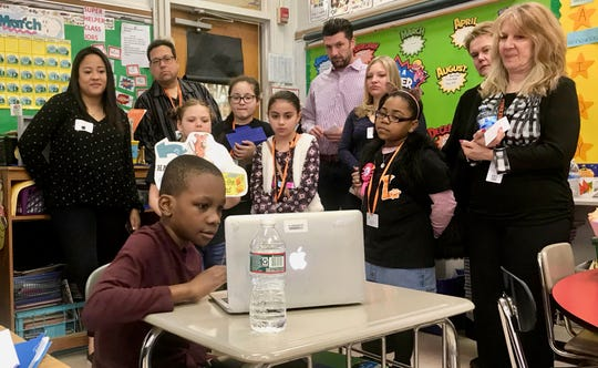 Adrien Williams, a third-grader at School No. 6 in Linden, showing a presentation he created about the Rev. Martin Luther King Jr. to visitors to his classroom on March 12. The tour was part of School No. 6's inclusion in the Apple Distinguished Schools program.