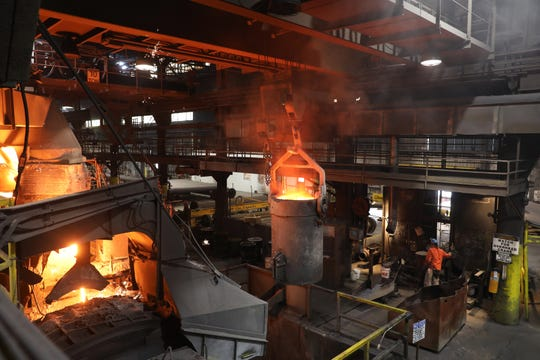 A crane lifts a crucible after it was filled with melted iron at McWane Ductile in Coshocton.