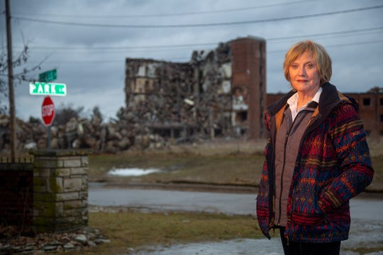 Miriam Kenning stands for a portrait in her driveway across from the half demolished St. Joseph Hospital in Ottumwa Wednesday, March 13, 2019. A dispute between developer Blackbird Investments and demolition contractor Elder Construction has halted work on the project since August 2018.