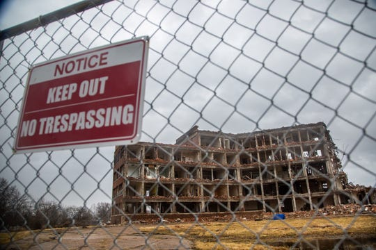St. Joseph Hospital in Ottumwa sits half demolished Wednesday, March 13, 2019. A dispute between developer Blackbird Investments and demolition contractor Elder Construction has halted work on the project since August 2018.