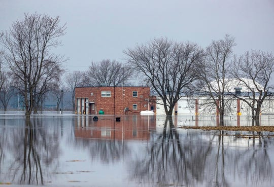 Floodwaters surround an Iowa Department of Transportation facility Monday, March 18, 2019, in Pacific Junction, Iowa. (Chris Machian/The World-Herald via AP)