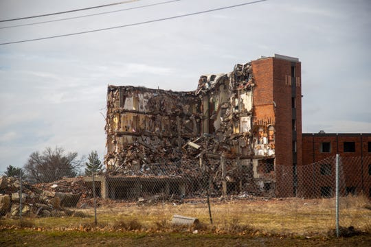St. Joseph Hospital in Ottumwa sits half demolished Wednesday, March 13, 2019. The building has been half torn down for months leaving neighbors wondering about its future.