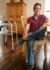 Robert Cotton, 51, of Ann Arbor has amyotrophic lateral sclerosis, better known as ALS or Lou Gehrig's disease. It is affecting his mobility, making it more and more difficult to walk.