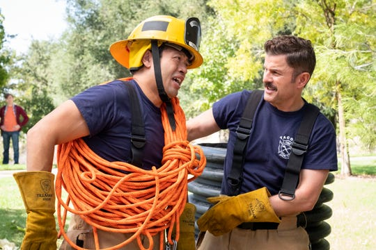 "Eugene Cordero, left, and Steve Lemme in TruTV workplace comedy ""Tacoma FD."""