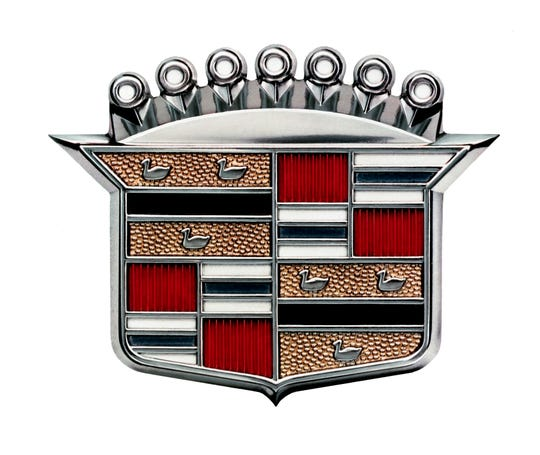 Cadillac's crest with merlette ducks in 1960. It is modeled off the founder of Cadillac family's coat of arms.