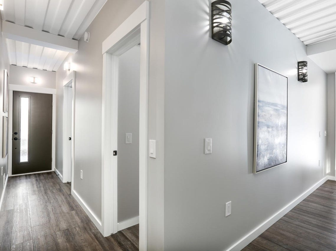 This 1,808-square-foot home on Inman Street in Ferndale was constructed from 5 ½ shipping containers. The high-end, contemporary home features three bedrooms, 2 1/2 bathrooms, 9-foot ceilings, a second-floor, walkout balcony, and a fully poured basement. It's one of several shipping container homes being developed in older metro Detroit suburbs, such as Ferndale.