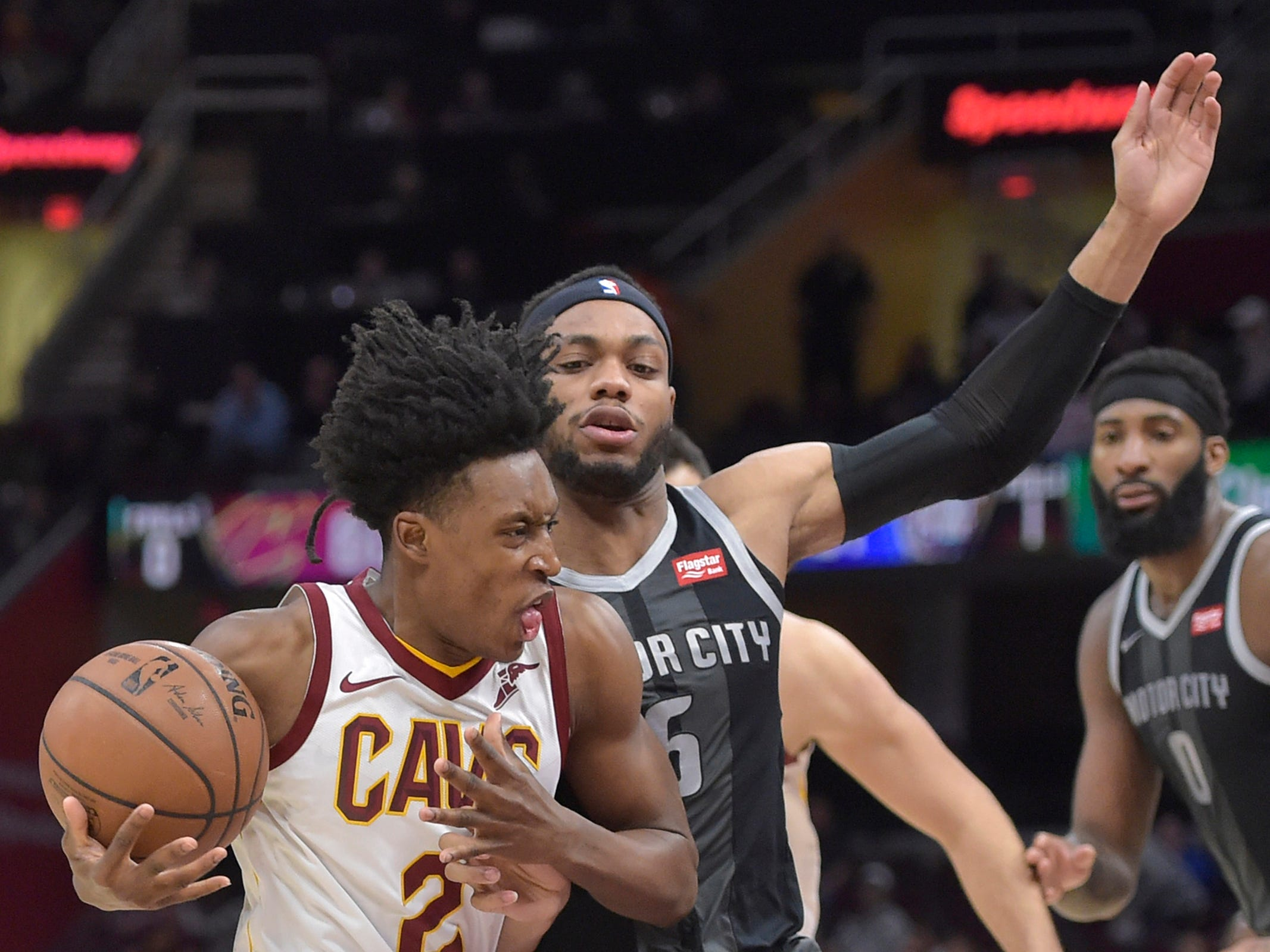 Cleveland Cavaliers guard Collin Sexton drives against Detroit Pistons guard Bruce Brown in the third quarter at Quicken Loans Arena, March 18, 2019.