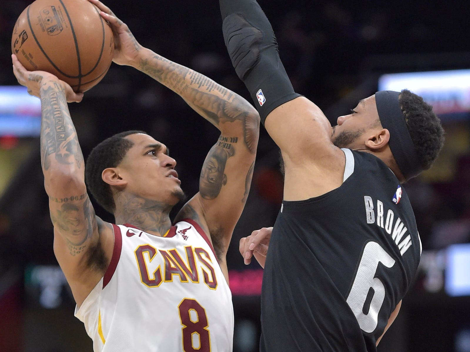 Cleveland Cavaliers guard Jordan Clarkson drives against Detroit Pistons guard Bruce Brown in the third quarter at Quicken Loans Arena, March 18, 2019.