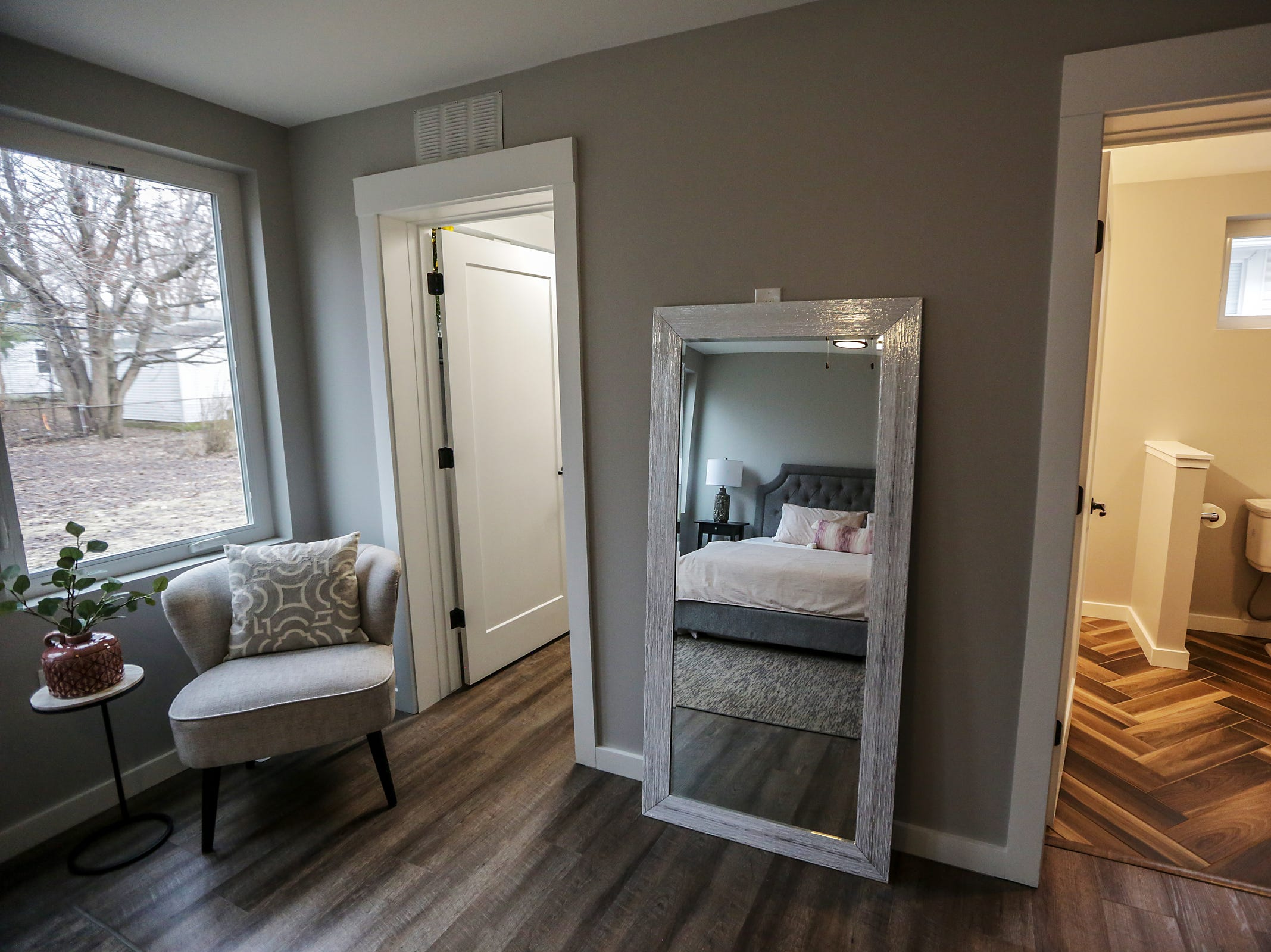 The master bedroom feature a custom bathroom and closet in the shipping container home in Ferndale, Mich. on Thursday, March 14, 2019.