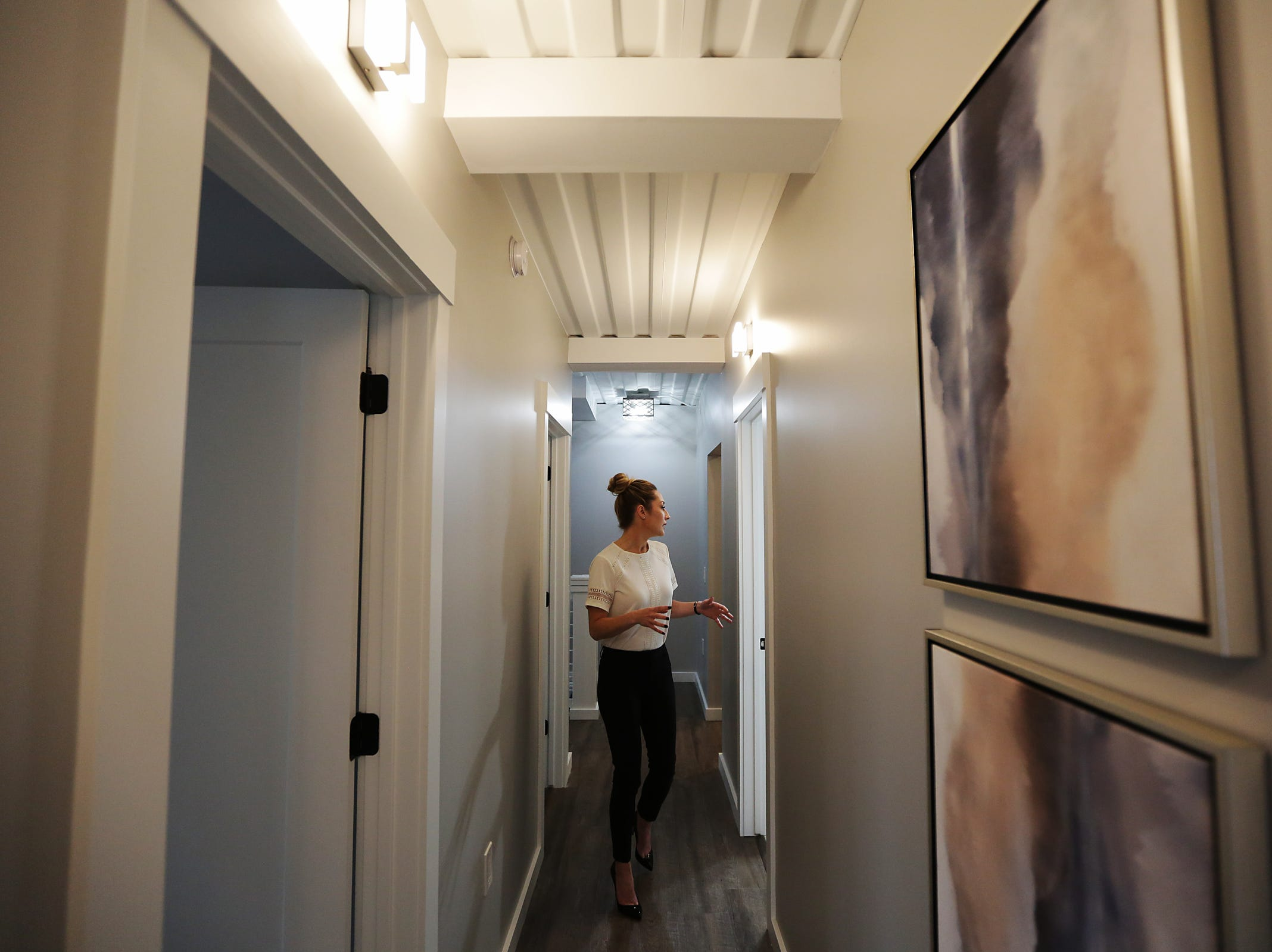 The shipping container home features 9-foot ceilings seen in the hallway leading to the bedrooms on the first floor, photographed on Thursday, March 14, 2019.
