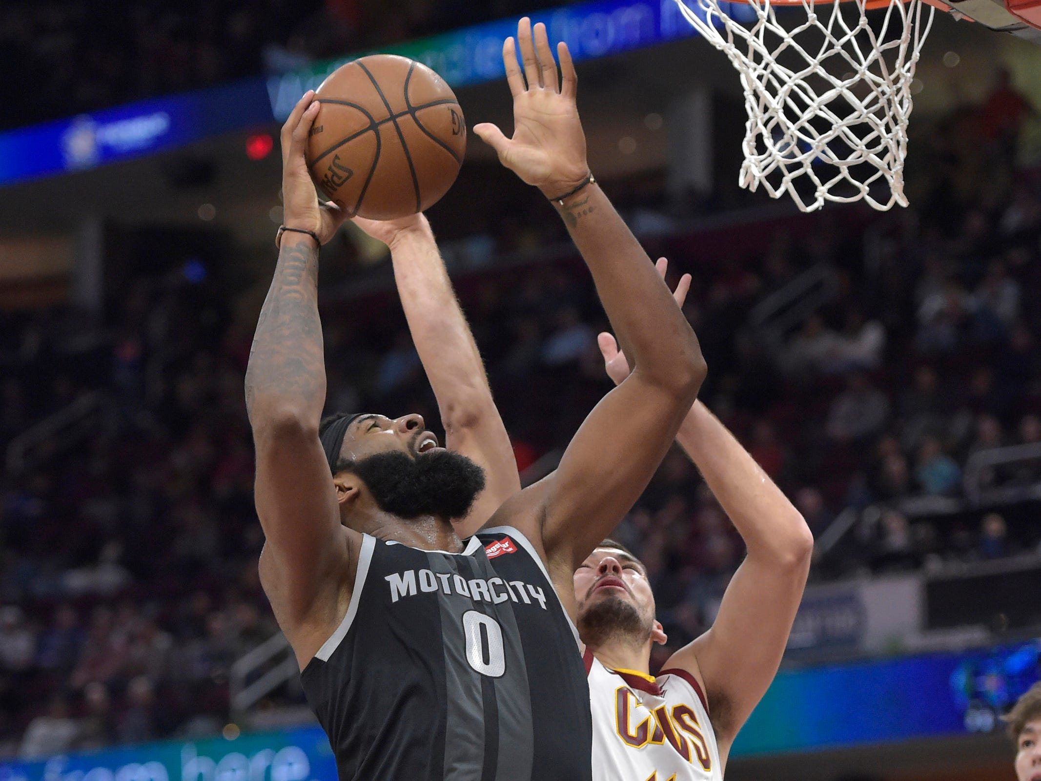Detroit Pistons center Andre Drummond shoots against Cleveland Cavaliers center Ante Zizic in the second quarter at Quicken Loans Arena, March 18, 2019.