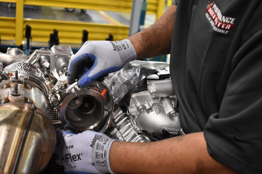 A worker at GM's plant in Bowling Green, KY. hand builds a Blackwing twin-turbo engine for Cadillac.