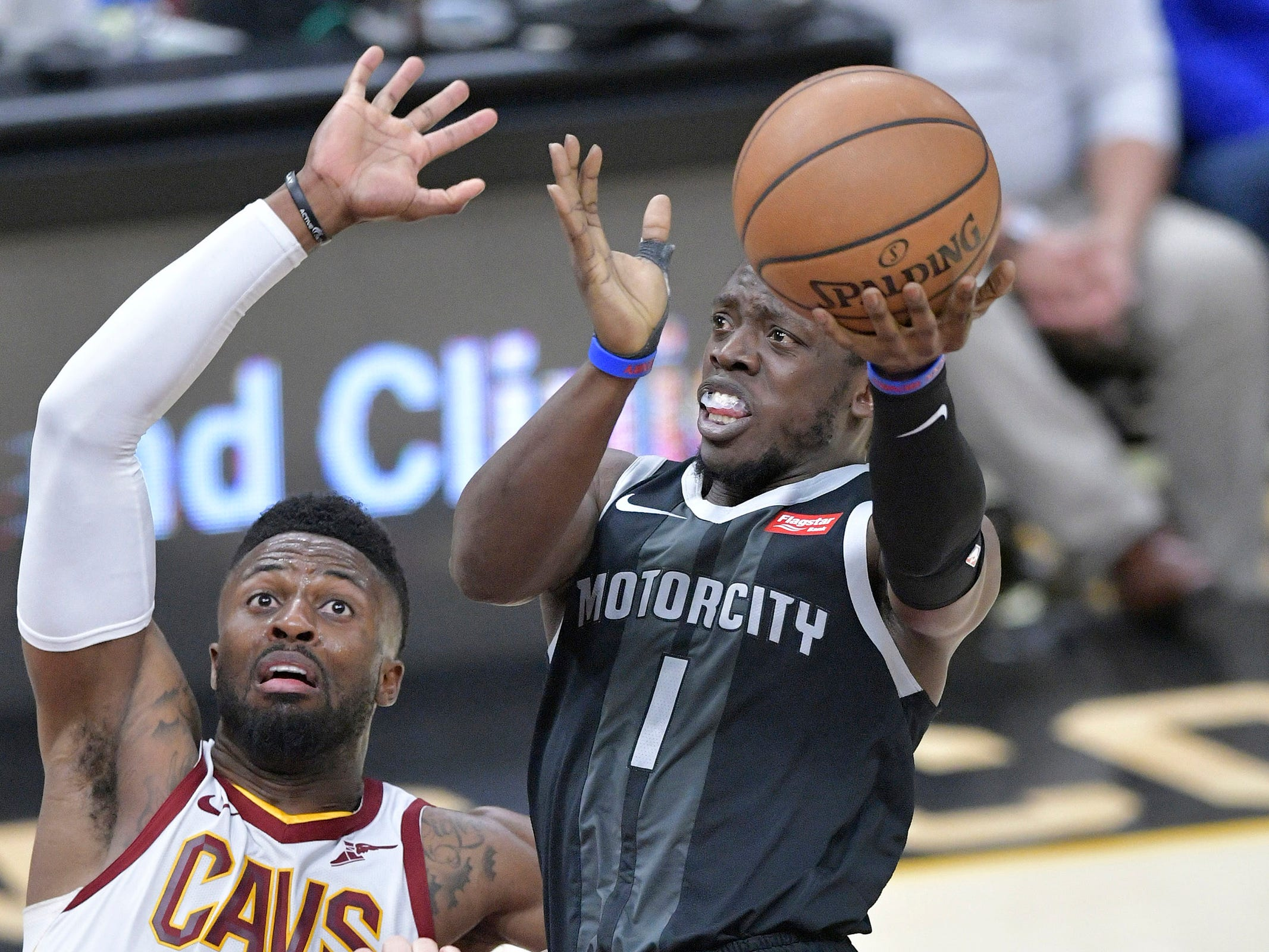 Detroit Pistons guard Reggie Jackson drives against Cleveland Cavaliers guard David Nwaba in the fourth quarter at Quicken Loans Arena, March 18, 2019.