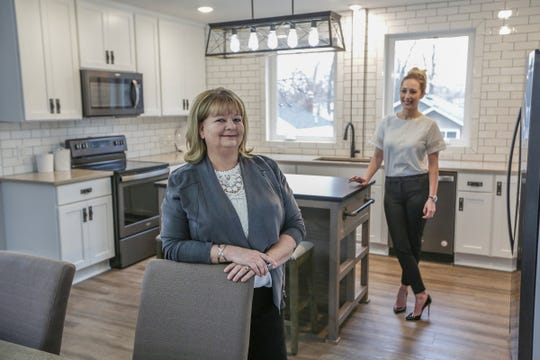 Dee Tignanelli, of Alpha to Omega Properties LLC, stands in the open concept second floor with her partner Stephanie Coyle, of Forever Home, in the Shipping container home they built in Ferndale, Mich. on Thursday, March 14, 2019.