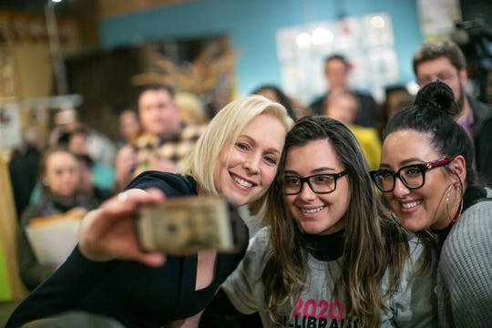 Angela Trpcevski, right, of Washington Township and Thea Barrak of Sterling Heights take a selfie with Democratic presidential candidate Kirsten Gillibrand during the Fems for Dems event held at Leon and Lulu in Clawson on Monday, March 18, 2019.