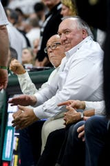 Former Michigan governor and former MSU interim president John Engler, right, and Peter F. Secchia sit court-side during the second half of the Michigan State, Michigan basketball game on Saturday, March 9, 2019, at the Breslin Center in East Lansing.
