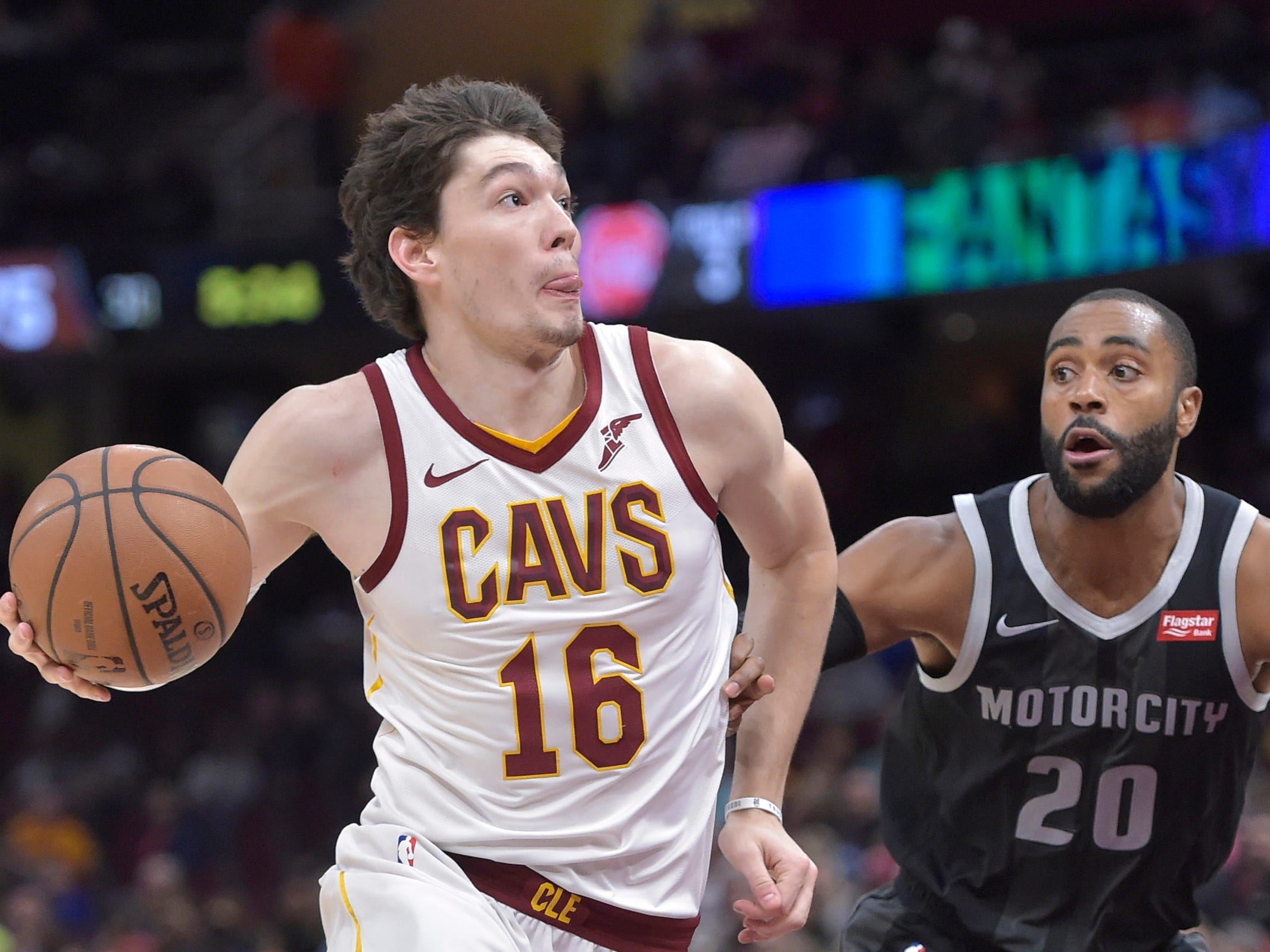 Cleveland Cavaliers forward Cedi Osman drives against Detroit Pistons guard Wayne Ellington in the third quarter at Quicken Loans Arena, March 18, 2019.