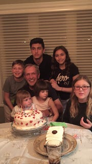 Thomas Quigley, 71, of Windsor, Ontario, celebrates his 70th birthday with his grandchildren, one year before his tragic death at Detroit Metro Airport.