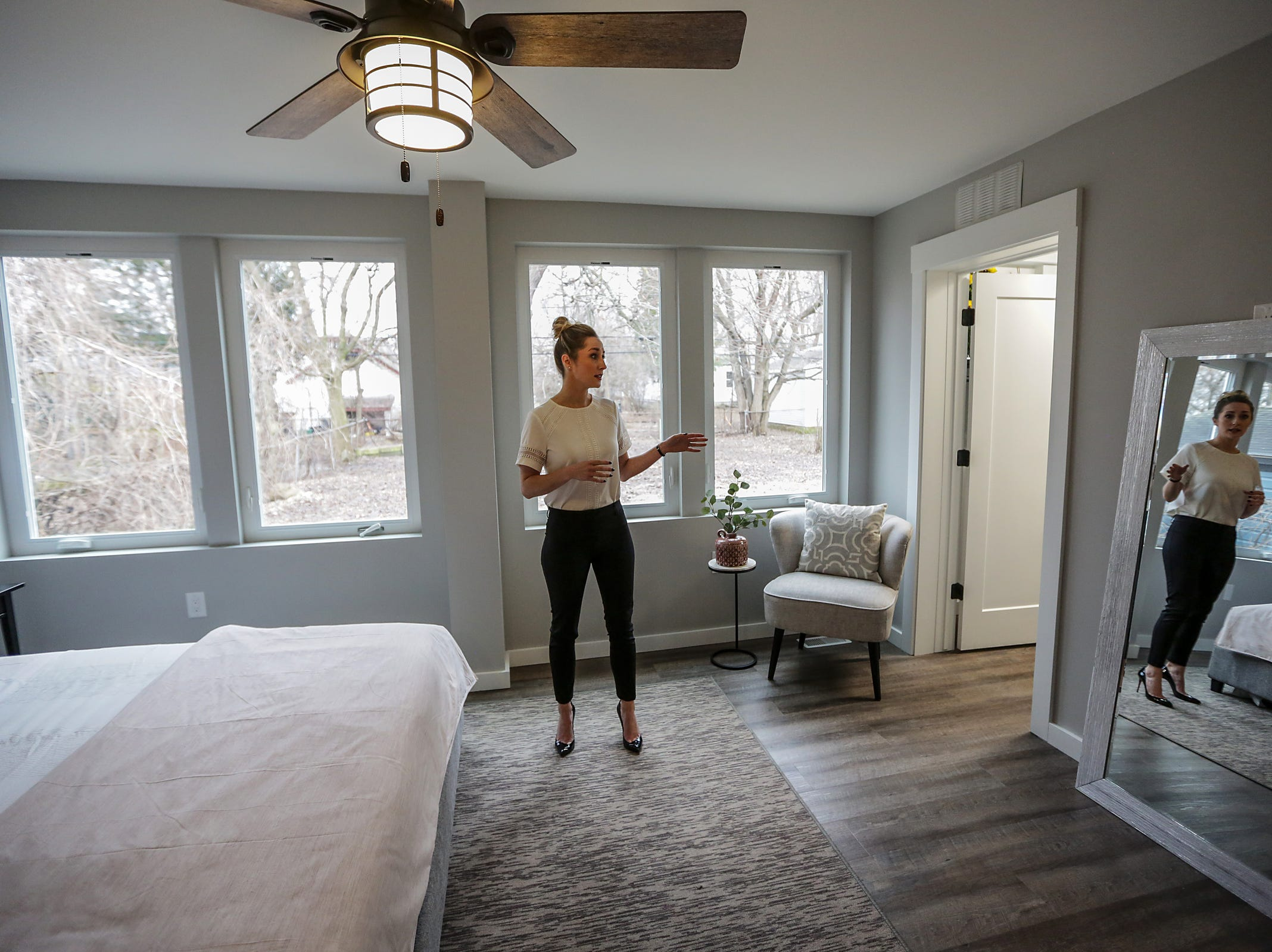 Realtor Stephanie Coyle shows the master bedroom, three shipping containers wide, photographed on Thursday, March 14, 2019.